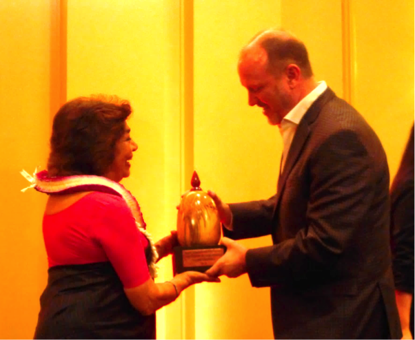 Aruna Vasudev receives the 2015 Vision in Film Award from HIFF Executive Director Robert Lambeth